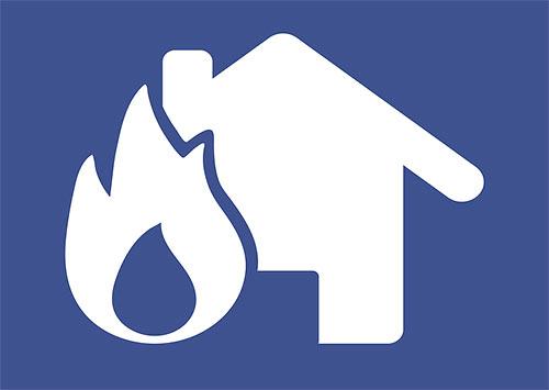 ikona domu z płomieniem symbolizująca pożar